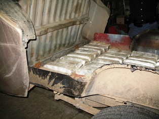 105 lbs of marijuana hidden in a truck's false bed