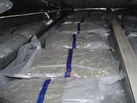 U.S. Customs agents find 460 pounds of Canadian marijuana hidden in the roof of a tractor trailer