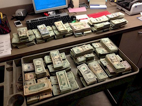 $400,000 cash seized after search of homes