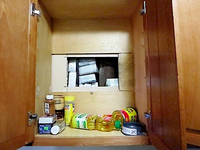Hidden Trap located in Kitchen Cabinet