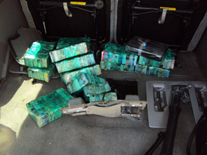 Bricks containing 25,000 street-ready glassine envelopes of heroin found in the hidden compartment.